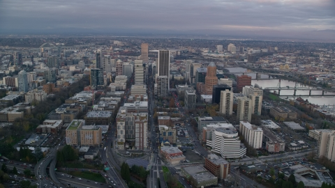AX155_150.0000000F - Aerial stock photo of Downtown Portland, Oregon at sunset, by the Willamette River