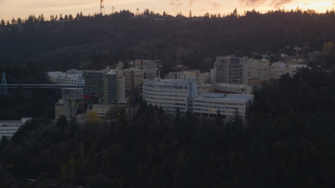 AX155_168.0000000F - Aerial stock photo of Oregon Health and Science University in Portland, Oregon, sunset