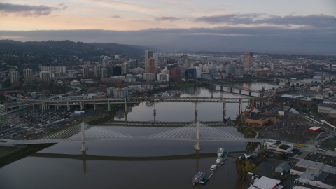 AX155_171.0000237F - Aerial stock photo of Willamette River and bridges, Downtown Portland at sunset, Oregon