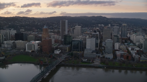 AX155_173.0000275F - Aerial stock photo of Hawthorne Bridge, waterfront park, and Downtown Portland at sunset in Oregon
