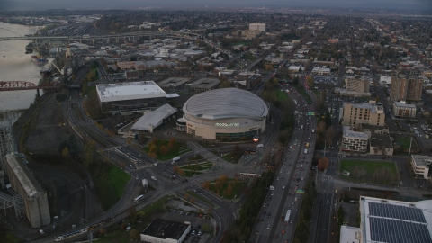 AX155_175.0000250F - Aerial stock photo of Light traffic on I-5 to Veterans Memorial Colosseum and Moda Center in Lloyd District, Portland, Oregon, sunset