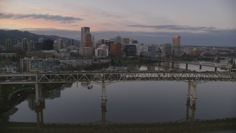 AX155_201.0000000F - Aerial stock photo of Marquam Bridge, near marina, Hawthorne Bridge, and downtown skyline at sunset, Downtown Portland, Oregon