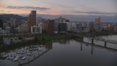 AX155_201.0000355F - Aerial stock photo of Marquam Bridge, marina, Hawthorne Bridge, and downtown skyline at sunset, Downtown Portland, Oregon
