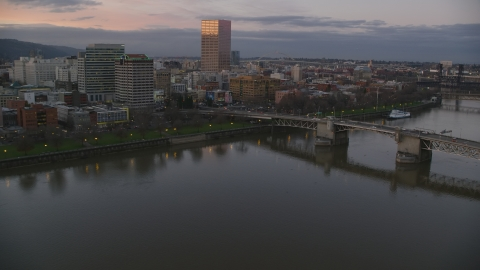 AX155_203.0000000F - Aerial stock photo of Morrison Bridge, waterfront park and downtown skyline at sunset, Downtown Portland, Oregon
