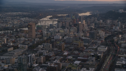 AX155_218.0000000F - Aerial stock photo of Downtown Portland cityscape by the Willamette River at sunset, Oregon