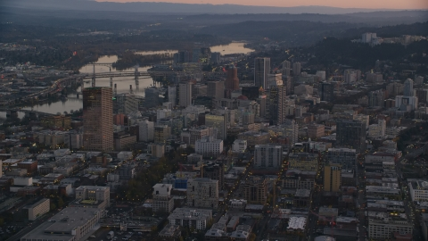 AX155_219.0000000F - Aerial stock photo of Downtown Portland cityscape by the Willamette River at sunset, Oregon