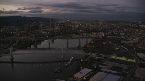 AX155_249.0000359F - Aerial stock photo of Downtown skyscrapers and bridges over the Willamette River at sunset, Downtown Portland, Oregon