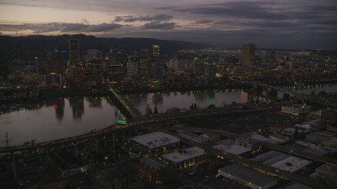 AX155_251.0000324F - Aerial stock photo of Skyscrapers and bridges over the Willamette River at sunset, Downtown Portland, Oregon