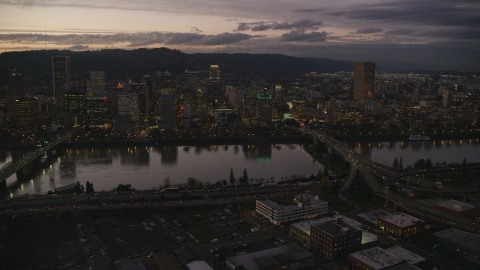AX155_252.0000258F - Aerial stock photo of Skyscrapers and bridges over the Willamette River at sunset, Downtown Portland, Oregon