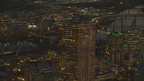 AX155_275.0000049F - Aerial stock photo of Top of US Bancorp Tower at night in Downtown Portland, Oregon