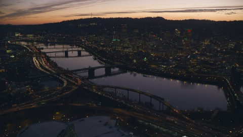 AX155_277.0000100F - Aerial stock photo of Willamette River, bridges and Downtown Portland, Oregon at sunset