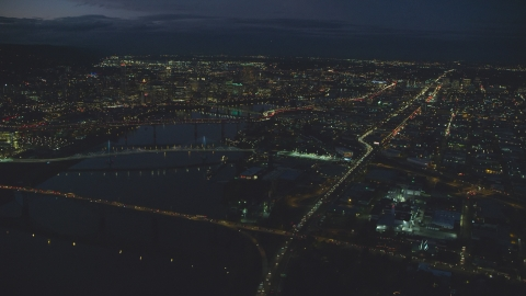 AX155_292.0000000F - Aerial stock photo of Downtown Portland cityscape, bridges on the Willamette River at night, Oregon