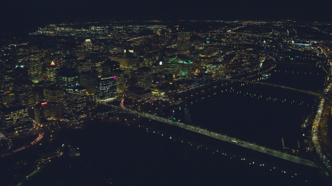 AX155_359.0000000F - Aerial stock photo of Downtown cityscape, bridges over the Willamette River at night, Portland, Oregon