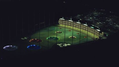 AX155_476.0000000F - Aerial stock photo of A Topgolf course in Hillsboro, Oregon at night