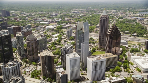 AX36_015.0000089F - Aerial stock photo of Skyscrapers including GLG Grand, Midtown Atlanta