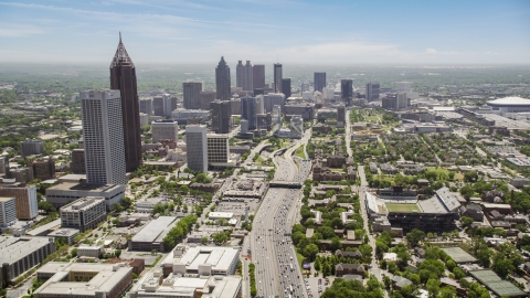 AX36_018.0000263F - Aerial stock photo of Downtown Connector and distant skyscrapers, Downtown Atlanta, Georgia