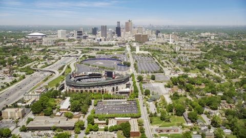 AX36_032.0000294F - Aerial stock photo of Turner Field and Downtown Atlanta skyline in the distance, Georgia