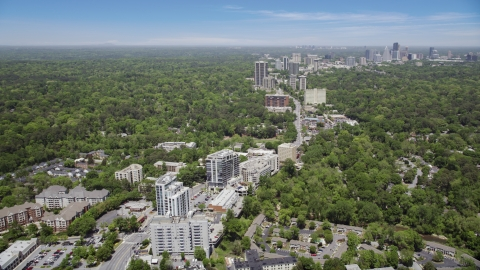 AX36_048.0000418F - Aerial stock photo of Peachtree road leading to skyscrapers and wooded area, Bulkhead, Georgia