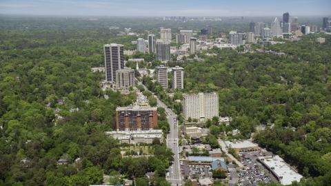 AX36_049.0000120F - Aerial stock photo of Peachtree Road through office buildings among wooded area, Bulkhead, Georgia