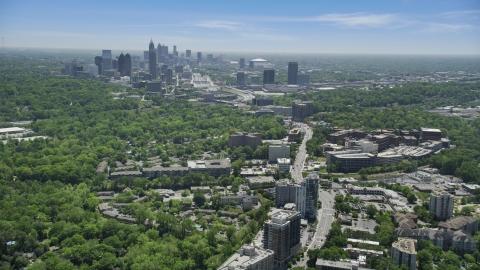 AX36_082.0000067F - Aerial stock photo of High above office buildings looking toward Midtown Atlanta skyline; Buckhead, Georgia