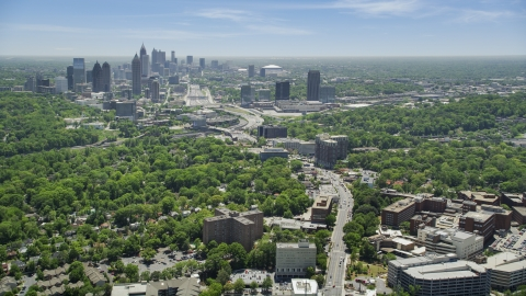 AX36_083.0000088F - Aerial stock photo of Peachtree Road toward Midtown Atlanta skyline, Georgia