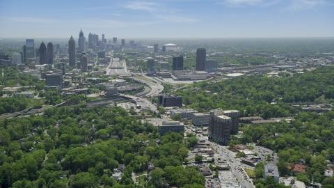 AX36_084.0000062F - Aerial stock photo of Peachtree Road toward Midtown skyline; Atlanta, Georgia