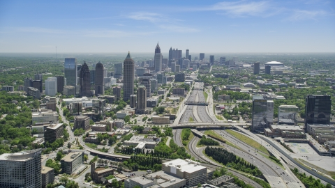 AX36_085.0000162F - Aerial stock photo of Downtown Connector toward Midtown Atlanta skyscrapers, Georgia
