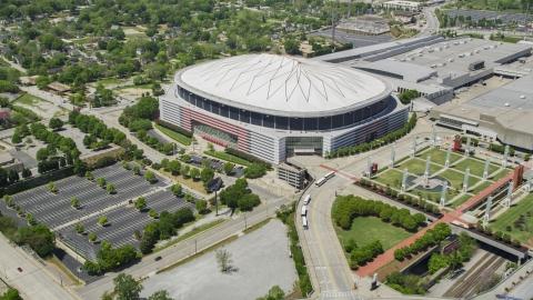 AX36_103.0000171F - Aerial stock photo of The Georgia Dome, surrounding parking lots, Downtown Atlanta, Georgia