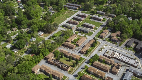 AX37_003.0000043F - Aerial stock photo of Abandoned residential buildings near Lincoln Cemetery, West Atlanta, Georgia