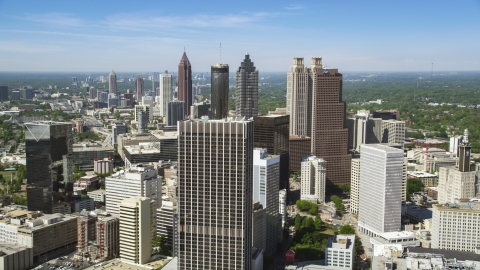 AX37_013.0000093F - Aerial stock photo of Downtown skyscrapers and office buildings under blue skies, Atlanta, Georgia
