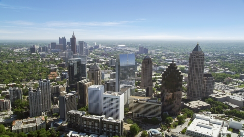 AX37_024.0000140F - Aerial stock photo of Midtown skyscrapers with Downtown in distance, Atlanta, Georgia
