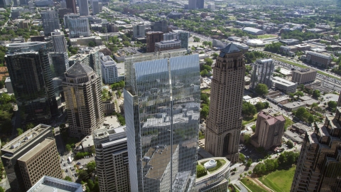 AX37_025.0000168F - Aerial stock photo of Looking down on 1180 Peachtree skyscraper, Midtown Atlanta