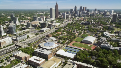 AX37_034.0000299F - Aerial stock photo of Georgia Institute of Technology with distant Midtown Atlanta skyscrapers, Georgia