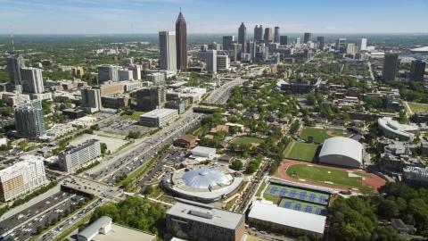 AX37_035.0000051F - Aerial stock photo of Alexander Memorial Coliseum, Downtown Connector, Midtown Atlanta, Georgia