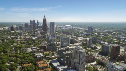 AX37_037.0000120F - Aerial stock photo of Midtown Atlanta skyscrapers with Downtown in the distance, Atlanta Georgia