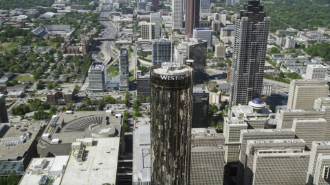 AX37_057.0000371F - Aerial stock photo of Westin Peachtree Plaza Hotel, Downtown Atlanta, Georgia