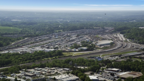 AX37_085.0000152F - Aerial stock photo of A train yard, hazy, Atlanta, Georgia
