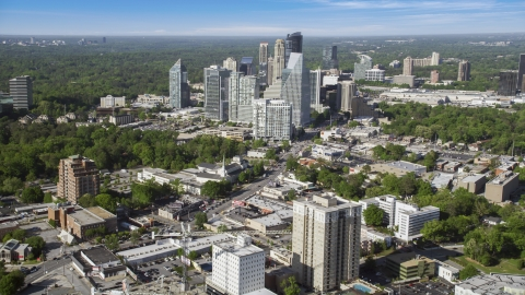 AX38_012.0000089F - Aerial stock photo of Skyscrapers overlooking forests, Buckhead, Georgia