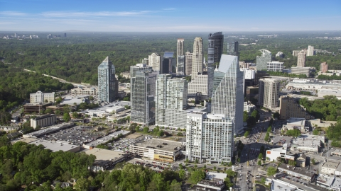 AX38_013.0000099F - Aerial stock photo of Terminus Atlanta and surrounding skyscrapers, Buckhead, Georgia