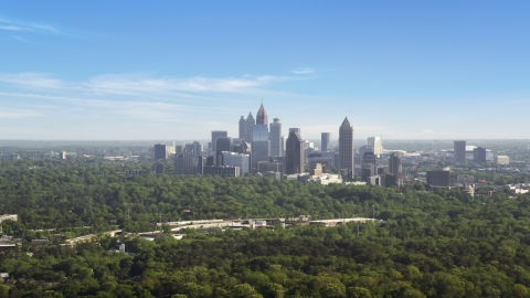 AX38_027.0000048F - Aerial stock photo of Distant shot of Midtown Atlanta skyscrapers beyond trees, Buckhead, Georgia