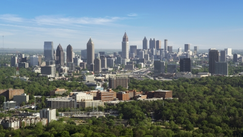 AX38_030.0000044F - Aerial stock photo of Midtown Atlanta skyline seen from Buckhead, Georgia