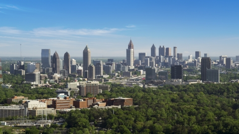 AX38_030.0000205F - Aerial stock photo of Midtown Atlanta skyline, hazy, Buckhead, Georgia
