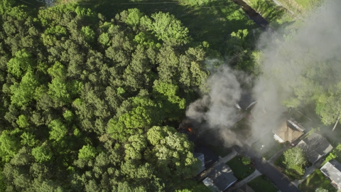AX38_037.0000175F - Aerial stock photo of Smoke rising from a burning home, West Atlanta, Georgia