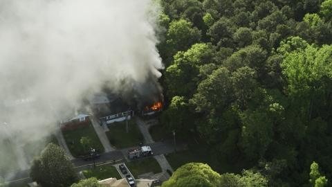 AX38_045.0000458F - Aerial stock photo of Rising smoke from a burning house, West Atlanta, Georgia