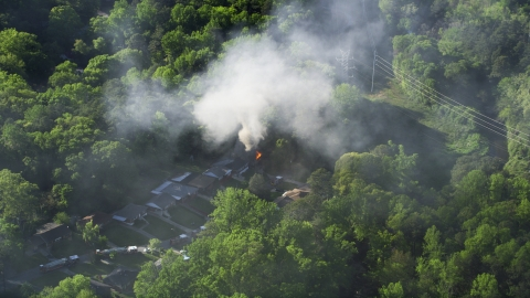 AX38_050.0000229F - Aerial stock photo of Smoke rising from a burning home, West Atlanta, Georgia