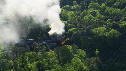 AX38_052.0000000F - Aerial stock photo of Smoke and flames rising from a burning home, West Atlanta, Georgia