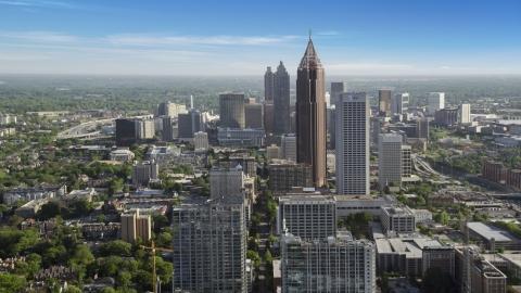 AX38_065.0000020F - Aerial stock photo of Bank of America Plaza and skyscrapers in Midtown Atlanta, Georgia
