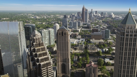 AX38_067.0000101F - Aerial stock photo of Midtown skyscrapers, Downtown the distance, Atlanta, Georgia