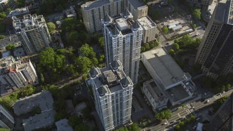 AX38_068.0000082F - Aerial stock photo of Tilt down on a condominium complex, Midtown Atlanta, Georgia