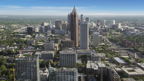 AX38_069.0000152F - Aerial stock photo of Bank of America Plaza, AT&T Midtown Center towering over citiy buildings, Midtown Atlanta
